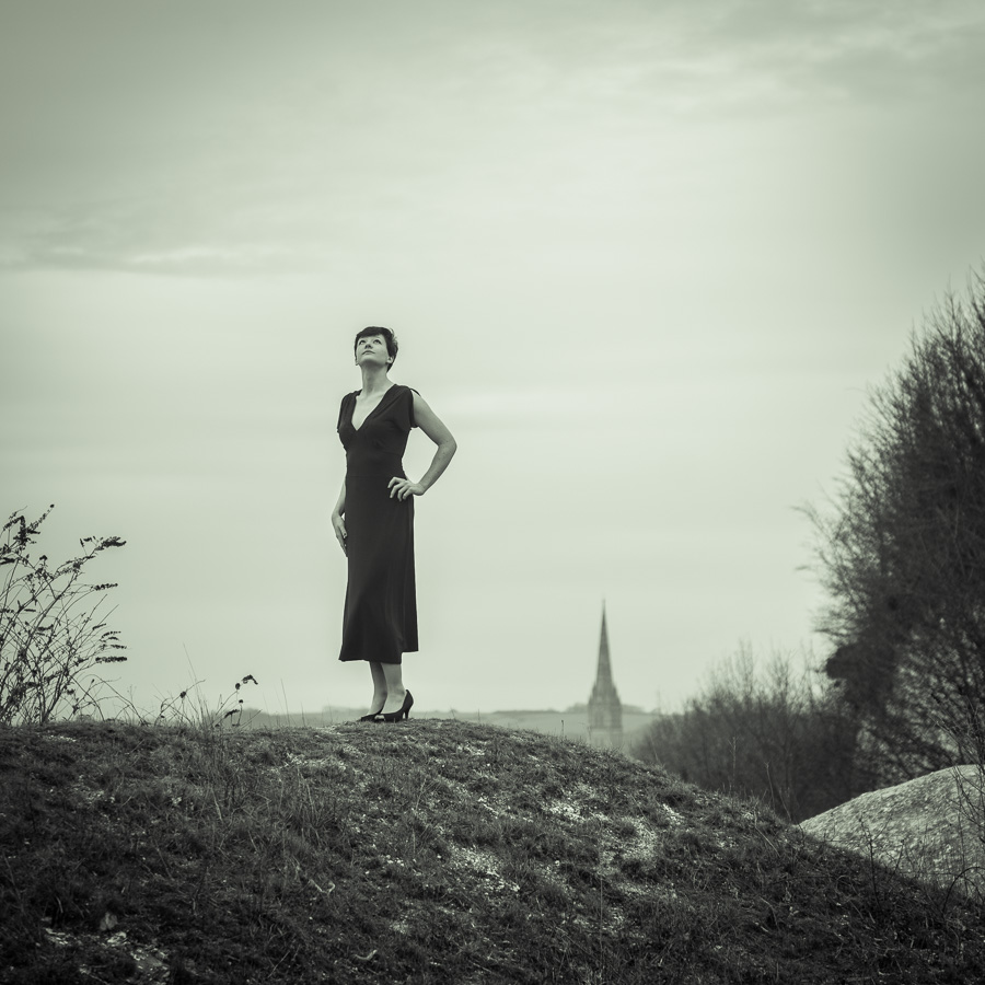 Monochrome full length portrait with a Spire